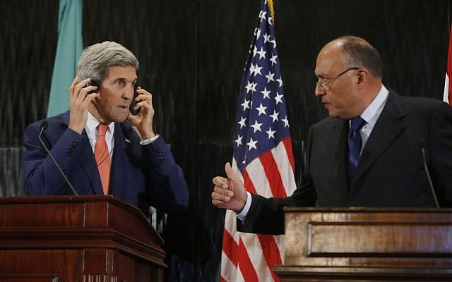 US Secretary of State John Kerry stands with Egypt's Foreign Minister Sameh Shukri during a press conference in Cairo, Friday, July 25, 2014. (photo credit: AP/Pool)