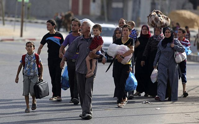 Palestinians flee their homes to take shelter at the United Nations school in Gaza City, Sunday, July 13, 2014 (photo credit: AP/Hatem Moussa)