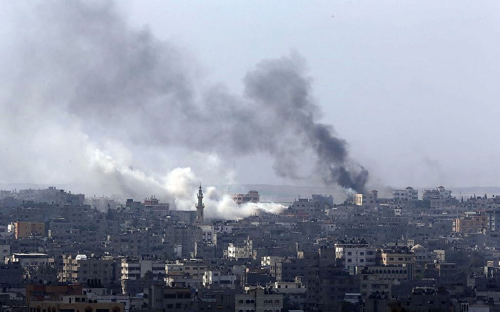 Smoke billows from an area hit by Israeli strikes in Gaza City in the northern Gaza Strip on Sunday, July 20, 2014. (photo credit: AP/Lefteris Pitarakis)