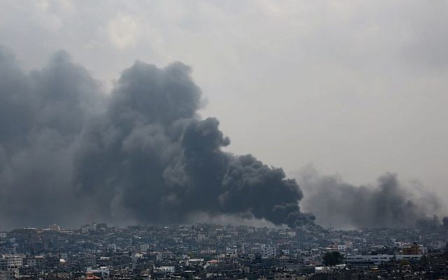 Smoke rises after an Israeli missile hits the Shejaiya neighborhood in Gaza City, northern Gaza Strip, Sunday, July 20, 2014.  (Photo credit: AP/Hatem Moussa)