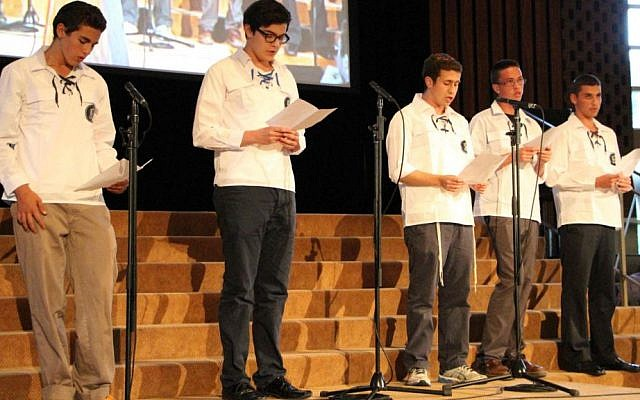Religious youth group Bnei Akiva sings 'Acheinu' ('Our Brothers') at Toronto memorial service for slain Israeli teens. (Courtesy)