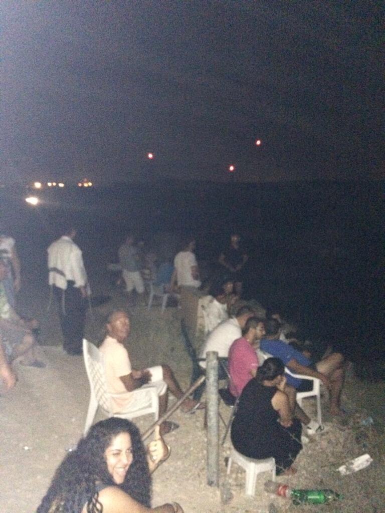 Israeli watch an airstrike on Gaza (photo credit: Allan Sorensen/Twitter)