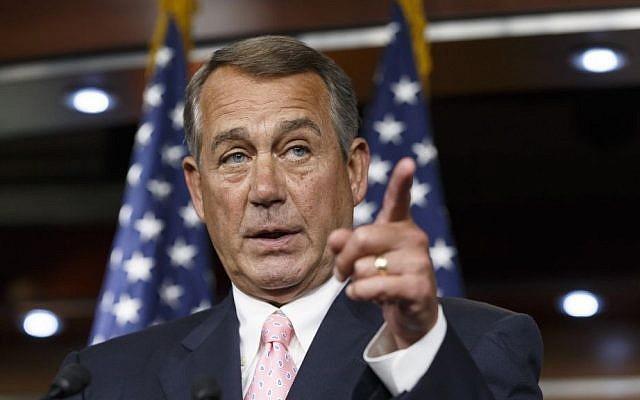 House Speaker John Boehner, R-Ohio, talks with the media on Capitol Hill in Washington (photo credit: AP/File)