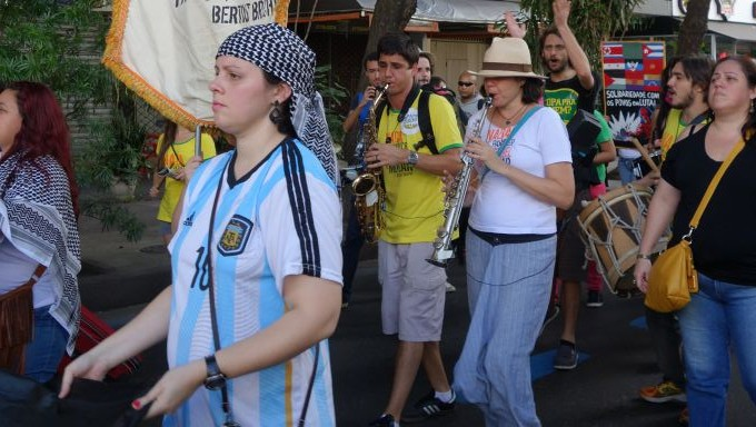 A Rio protester dons a Messi jersey and a keffiyah, a garment associated with the pro-Palestinian camp. (Greg Scruggs/Times of Israel)