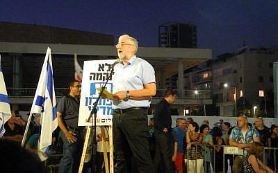 MK Amram Mitzna (HaTnua) addressed the crowd at an anti-incitement rally in Tel Aviv, July 03, 2014. (photo credit: Melanie Lidman)