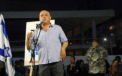 MK Issawi Frej (Meretz) quotes lines from the Palestinian poet Mahmoud Darwish during an anti-incitement rally in Tel Aviv, July 03, 2014. (photo credit: Melanie Lidman)
