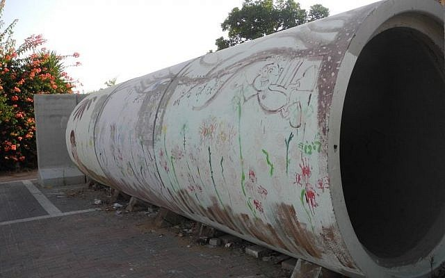 A painted reinforced concrete pipe serves as a bomb shelter for up to three families in Nitzan.  photo credit: Melanie Lidman/Times of Israel)