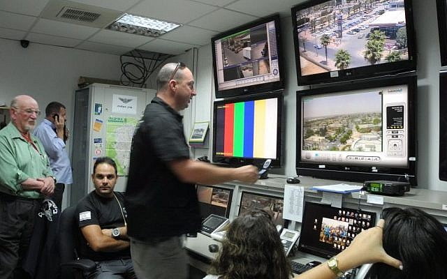 Erez Tidhari, the director of security for the town of Netivot, at the security control center next to the municipality building.  (Melanie Lidman/Times of Israel)
