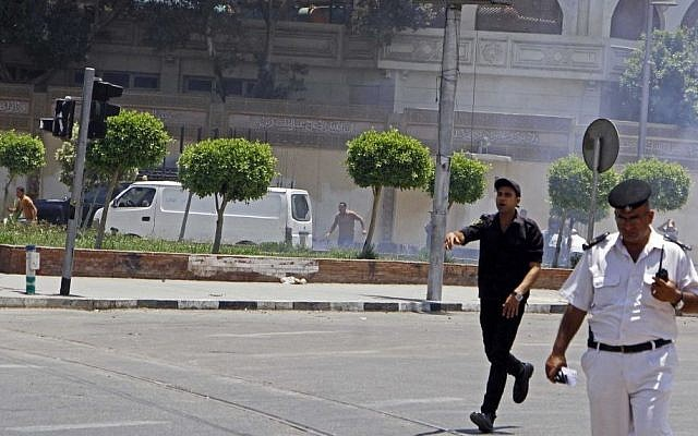 Egyptian security forces inspect the scene after two homemade bombs went off near the presidential palace in Cairo, Egypt, Monday, June 30, 2014 (AP Photo/Ahmed Abdel Fattah, El Shorouk Newspaper)