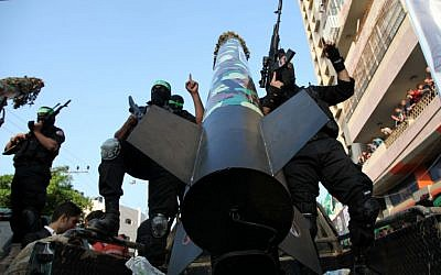 Hamas militants display the M-75 rocket in a military parade commemorating Operation Pillar of Defense in Gaza, November 14, 2013 (photo credit: Emad Nassar/Flash90)