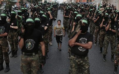 Members of the Izz ad-Din al-Qassam Brigades, Hamas's armed wing, stage an anti-Israel parade as part of the celebrations marking the first anniversary of an Israeli army operation in Gaza, November 14, 2013 (photo credit: Wissam Nassar/Flash90)