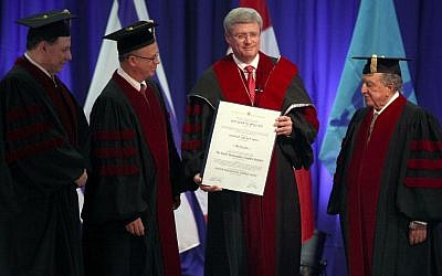 Canada's Prime Minister Stephen Harper (2nd R) stands next to Tel Aviv University president Prof. Joseph Klafter (3rd R), Prof. Aron Shai, and architect and businessman David Azrieli (R), after the latter was awarded a honorary Ph.D degree from Tel Aviv University in Tel Aviv on January 22, 2014. (photo credit: Gideon Markowicz/Flash90)