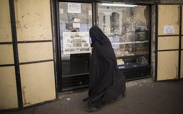 An ultra-Orthodox Jewish woman, covered from head to toe, in the Mea Shearim neighborhood of Jerusalem (illustrative photo: Yonatan Sindel/Flash 90)