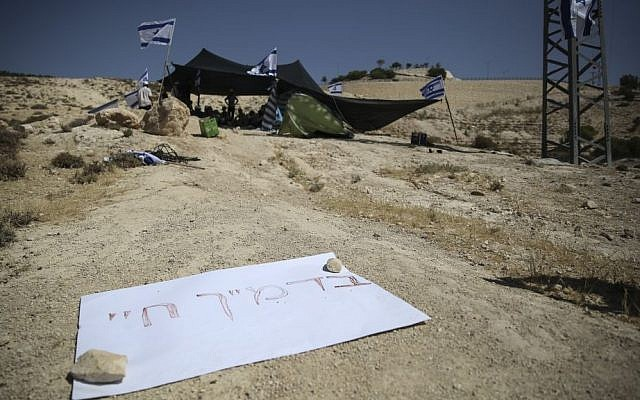 Jewish right-wing activists seen setting up tents and establishing an outpost on a hill in the controversial E1 area near Maale Adumim, in response to the murder of three young Jewish boys, Eyal Yifrach, Gilad Sha'ar and Naftali Fraenkel. (photo credit: Hadas Parush/Flash90)