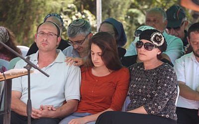 Ofir (L) and Bat Galim (R) Sha'ar, parents of the late Gil-ad Sha'ar, at the funeral procession ceremony on July 1, 2014 (photo credit: Flash90)