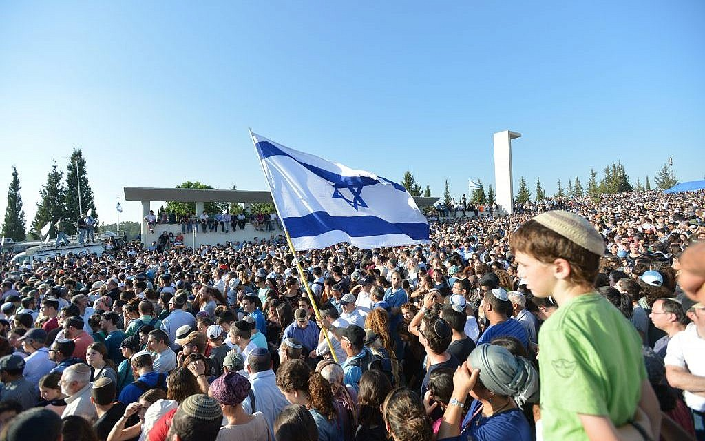 Tens of thousands of people at the funeral for Gil-ad Shaar, Naftali Fraenkel and Eyal Yifrach in Modiin (photo credit: Flash90)