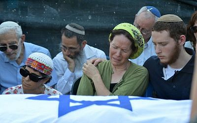 Rachelle Fraenkel crying over the body of her son Naftali at his funeral, July 2014 (photo credit: Flash90)