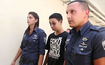 Tariq Abu Khdeir, a US citizen, and cousin of murdered 16-year old Mohammed Abu Khdeir, is brought into the Magistrate's Court in Jerusalem on July 06, 2014. Tariq, detained during violent protests, was granted a conditional release by the Court. His parents have charged that their son was beaten by Israeli police during clashes over the killing of his Palestinian cousin (Photo cedit: FLASH90)