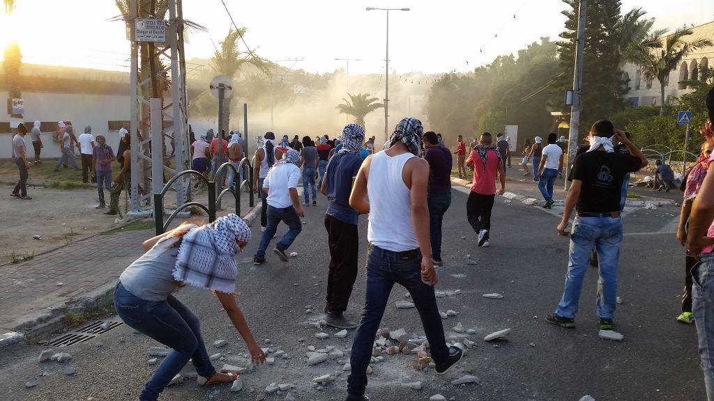 Rioters facing off against police in Arara Saturday. (photo credit: Tamer Khalifa/FLASH90)