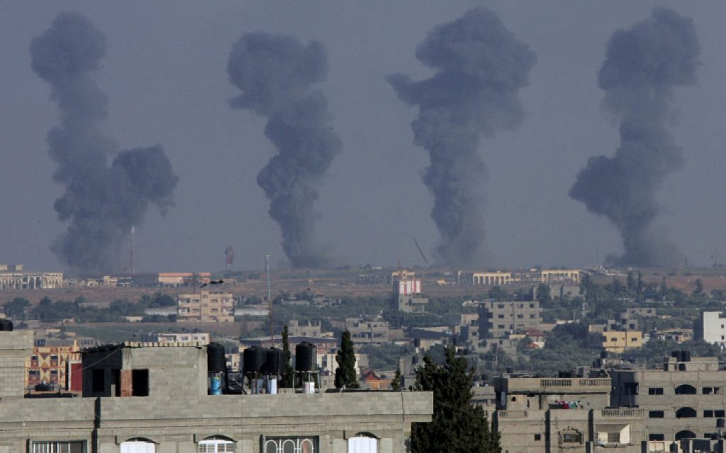 Black smoke rises after an Israeli air strike on the Gaza International Airport in Rafah, southern Gaza, on July 7, 2014. (photo credit: Abed Rahim Khatib/Flash90)