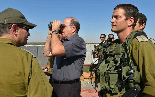 Defense Minister Moshe Ya'alon seen during a visit at the Gaza Division of the IDF Southern Command, July 8, 2014. (photo credit: Ariel Hermoni/Ministry of Defense/Flash90)