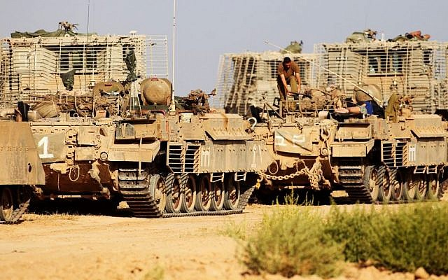 IDF APCs (Armed Personnel Carriers) near the Gaza border on the first day of Operation Protective Edge, July 8, 2014. (Photo credit: David Buimovitch/Flash90)