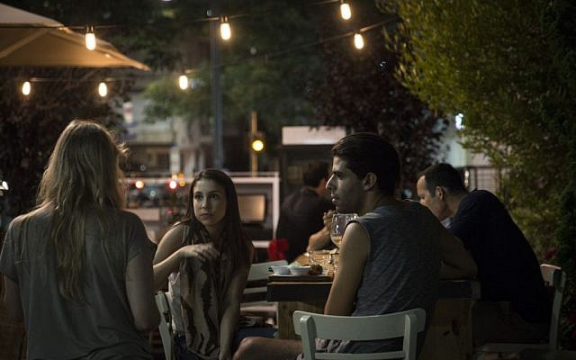 Israelis having a drink in Tel Aviv shortly after a rocket siren sounded on July 8. (photo credit: Hadas Parush/Flash90)