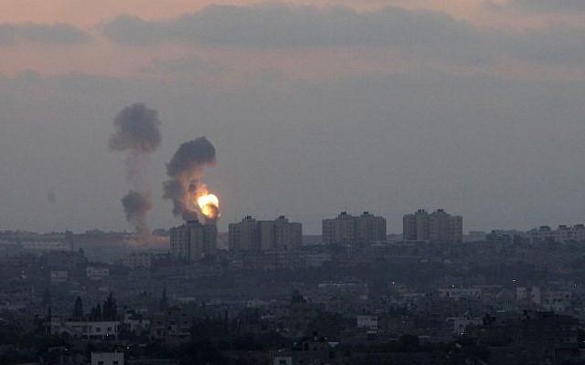 Smoke rises over Gaza after an Israeli airstrike following several rockets attacks into southern Israel, Tuesday, July 8, 2014. (photo credit: Miriam Alster/ Flash90)