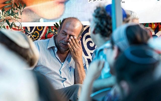 The father of Muhammad Abu Khdeir is seen in the family mourning tent in the East Jerusalem neighborhood of Shuafat, Tuesday, July 8, 2013 (photo credit: Noam Revkin Fenton/Flash90)