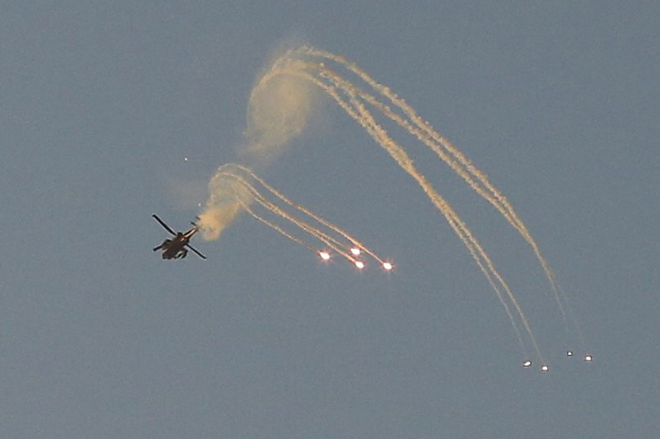 An Israeli Apache helicopter shoots a missile over the Gaza Strip on July 9, 2014, the second day of Operation Protective Edge. (photo credit: Edi Israel/Flash90)