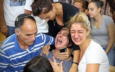 Relatives of 20-year-old Shelley Dadon, who was found dead in northern Israel in May of this year, grieve in the Nazareth District Court, where Yousef Hussein Halifa was indicted for the teen's alleged murder, Wednesday, July 09, 2014. (photo credit: Hagain Aharon/Flash90)