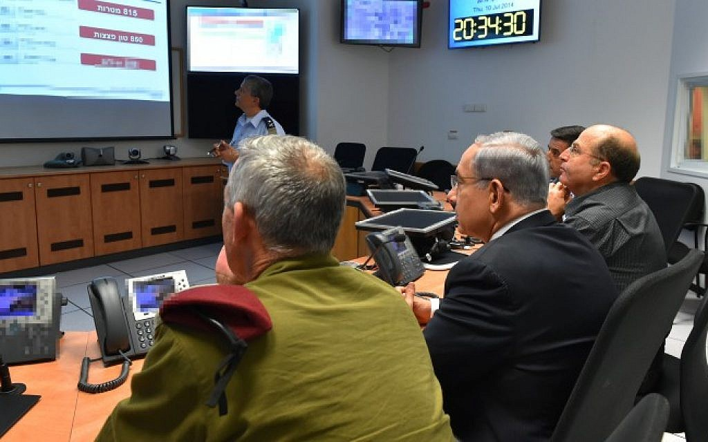 Prime Minister Benjamin Netanyahu (center), Defense Minister Moshe Boogie Yaalon (right) and IDF Chief of Staff Benny Gantz seen during a meeting at the situation room of the Israeli Air Force on July 10, 2014, on the third day of Operation Protective Edge. (Photo credit: Ariel Hermoni/Ministry of Defense/Flash90)