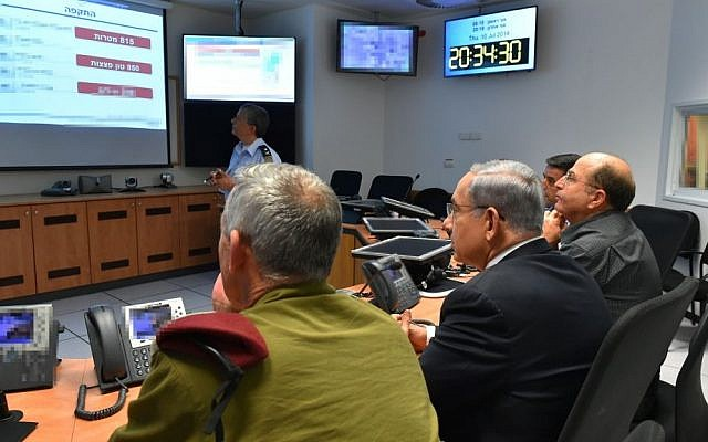Prime Minister Benjamin Netanyahu (C), Defense Minister Moshe Ya'alon (R), and IDF Chief of Staff Benny Gantz seen during a meeting in the situation room of the Israeli Air Force on Thursday, July 10, 2014, the third day of Operation Protective Edge. (photo credit: Ariel Hermoni/Defense Ministry/Flash90)