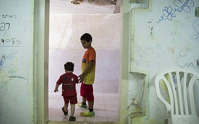 Children are seen in a bomb shelter of an apartment building in Ashkelon, southern Israel, on the third day of Operation Protective Edge, Thursday, July 10, 2014. (photo credit: Hadas Parush/Flash90)