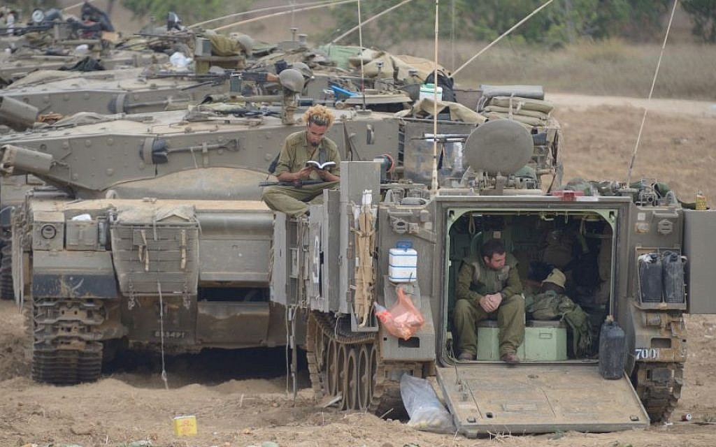 IDF tanks and soldiers in southern Israel near the border with Gaza, on the fourth day of Operation Protective Edge, July 11, 2014. (Photo credit: Gili Yaari/Flash90)