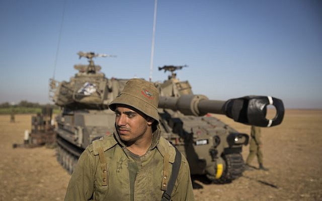 Israeli Artillery Corps soldiers seen in a field near the border with Gaza in South Israel, on the fourth day of Operation Protective Edge, July 11, 2014. (photo credit: Hadas Parush/Flash90)