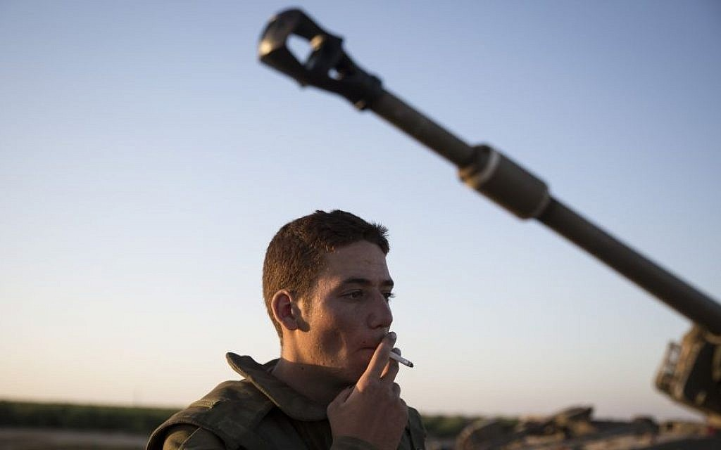 An Artillery Corps soldier is seen in a field near the border with Gaza in southern Israel, on the fourth day of Operation Protective Edge, July 11, 2014. (photo credit: Hadas Parush/Flash90)