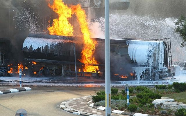 Flames rise at a gas station in Ashdod that was hit directly by rocket fire from Gaza on the fourth day of Operation Protective Edge, July 11, 2014. The rocket caused explosions and three people were injured, one of them critically. (Photo credit: Flash90)