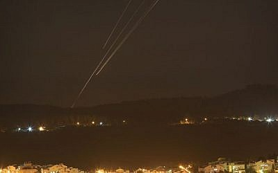 Rockets seen flying over central Israel on the fifth day of Operation Protective Edge, July 12, 2014. (Nati Shohat/Flash90)