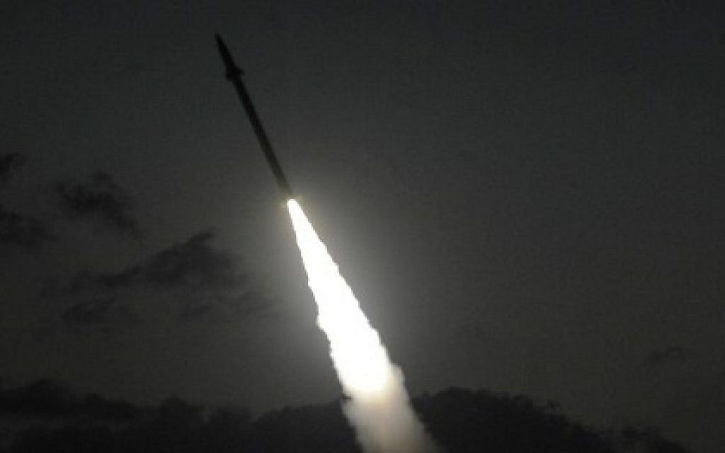 Illustrative. An Iron Dome missile defense battery fires an intercepting missile on July 13, 2014. (David Buimovitch/Flash90)