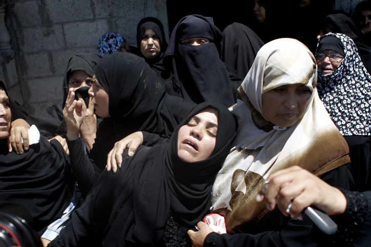 Palestinian relatives mourn during the funeral of four members of the Moamer family, including a 26-year-old militant of the Hamas movement, during their funeral in southern Gaza Strip city of Rafah on July 14, 2014 (photo credit: Abed Rahim Khatib/Flash90)