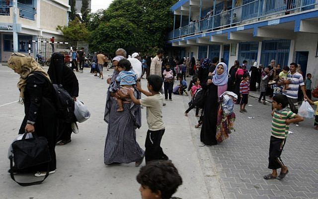 Palestinians at an UNRWA school after fleeing their homes following an Israeli ground offensive in Rafah in the southern Gaza Strip, on July 18, 2014. (photo credit: Abed Rahim Khatib/Flash90)