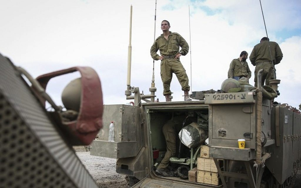 IDF forces seen gathering near the border with Gaza in Southern Israel on July 18, 2014. (Photo credit: Hadas Parush/Flash90)