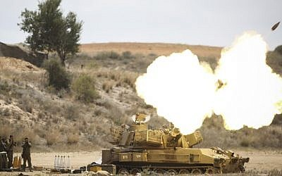 IDF Artillery Corps seen firing shells to Gaza, near the border in Southern Israel on July 18, 2014, after Israeli forces began a ground invasion in an escalation of the operation as it entered its 11th day. (Photo credit: Hadas Parush/Flash90)