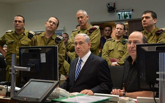 Illustrative: Prime Minister Benjamin Netanyahu with IDF chief Lt. Gen. Benny Gantz (standing directly behind him) and then-defense minister Moshe Ya'alon (seated right), monitoring IDF ground operations in Gaza during a meeting at the Kirya military headquarters in Tel Aviv on July 18, 2014. (Haim Zach/GPO/Flash90)