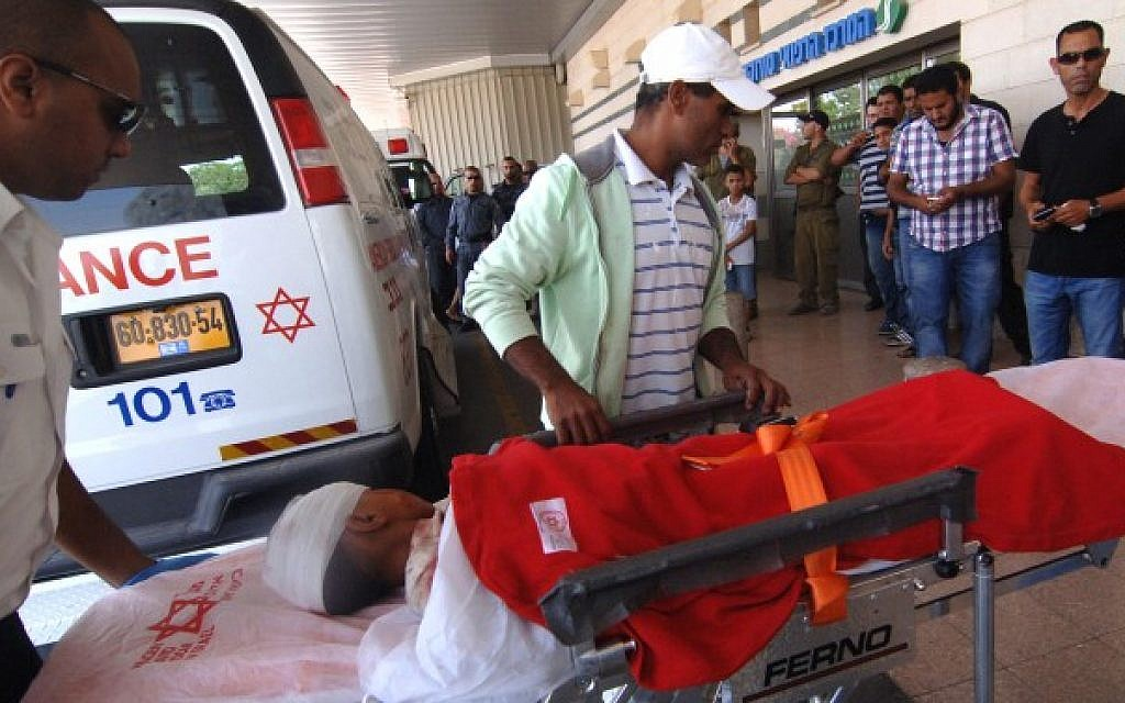 A Bedouin child is brought to the emergency room at Soroka hospital in Beersheba, after his family home, a shed in an unrecognized Bedouin village near Dimona, was hit by a rocket fired from Gaza, on July 19, 2014. (Photo credit: Dudu Greenspan/Flash90)