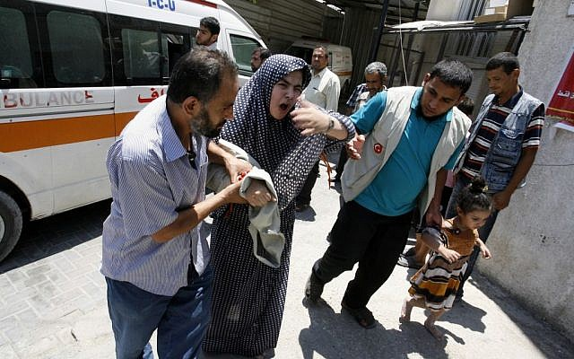 A Palestinian woman is helped out of an ambulance as she arrives at al-Najar hospital following an Israeli air raid on Rafah in the southern of Gaza strip, on July 20, 2014 (photo credit: Abed Rahim Khatib/Flash90)