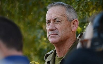 IDF Chief of Staff Benny Gantz gives a statement to the media near the Israel-Gaza border on July 20, 2014, describing progress of the ground offensive against Hamas soon after the IDF confirmed the deaths of 13 Golani Brigade soldiers in fighting in Gaza's Shejaiya district (Photo credit: Mendy Hechtman/Flash90)