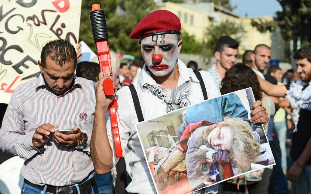 Israeli-Arabs take part in a protest in the northern city of Nazareth, against Israel's offensive in the Gaza Strip July 21, 2014. (photo credit: Flash90)
