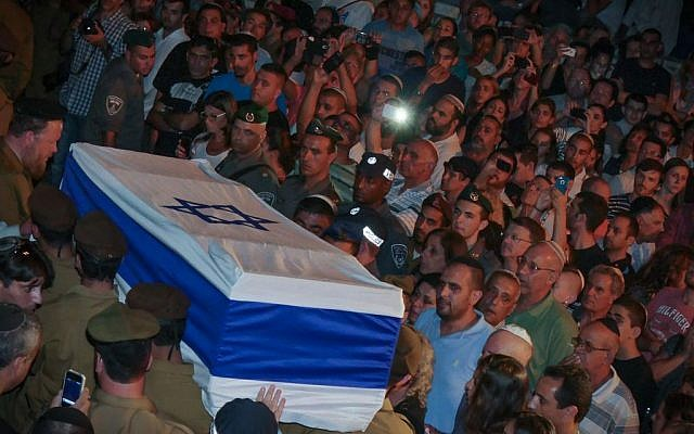 Thousands of Israelis attend the funeral of IDF soldier Nissim Sean Carmeli, from Texas, at the military cemetery in Haifa, Monday, July 21, 2014. (Photo credit: FLASH90)